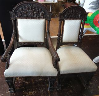 "Set of 6 Antique Carved Oak Dining Chairs Set of 6 Antique Carved Oak Dining Chairs. Circa 1900. Includes 2 Captains Arm Chairs & 4 Side Chairs. Arm chairs measures 45-1/2"" tall x 27"" wide x 26"" deep. Side chairs measure 44"" tall x 20"" wide x 22"" deep. Overall condition is good with minor wear. Several surface scratches. Fabric is stained. Starting Bid $50 for All 6. Auction Estimate $750 - $1,000."