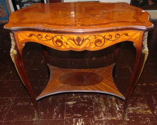 """Antique French Inlaid Side Table Antique French Inlaid Side Table with Bronze mounts. Measures 29-1/4"""" tall x 33"""" wide x 23-1/3"""" deep. Overall condition is good with minor wear. Several Shipping Options Available. Starting Bid $50. Auction Estimate $150 - $250."""