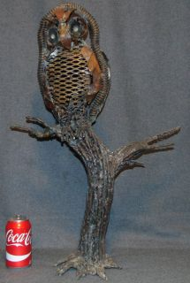 """Mid-Century Bronze Owl Sculpture by Florence Krieger Mid-Century Bronze Owl Sculpture by Listed Artist Florence Krieger (American 1919-2011). Measures 27"""" tall x 18-1/2"""" wide. Artist Signed. Condition is very good. Florence Krieger is a well listed and exhibited Brooklyn artist who worked in a variety of mediums. Recipient Purchase award Art Students League, 1965, Salmagundi Club prize, 1980, Knicherbocker Artists award, 1988. Member Allied Artists American, Catherine Lorillard Wolfe Art Club, American Artist Professional League, Knickerbocker Arts, National Art Club, Riverside Museum. Starting Bid $100. Auction Estimate $750 - $1,000."""