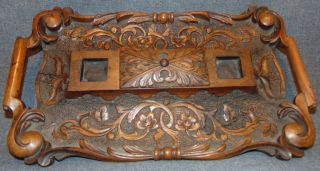 """Antique Oak Double Inkwell Antique Carved Oak Double Inkwell or Inkstand. (No Glass ink well inserts present). Measures 17"""" wide x 10"""" deep x 2"""" tall. Overall condition is good with minor wear typical from age. Several Shipping Options Available. Starting Bid $30. Auction Estimate $30 - $40."""