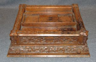 """Antique Oak Double Inkwell with Drawer Antique Carved Oak Double Inkwell or Inkstand. 1 large Drawer and two ink wells. (No Glass ink well inserts present). Measures 13-1/2"""" wide x 10-3/4"""" deep 4"""" tall. Overall condition is good with some ink stains and minor wear typical from age. Several Shipping Options Available. Starting Bid $50. Auction Estimate $50 - $60."""