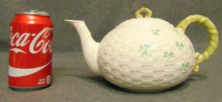 "Large Belleek Classic Shamrock Teapot Large Belleek Classic Shamrock Teapot. Measures 5-1/2"" tall x 10"" wide. Condition is Like New. Excellent. No Damage. Bottom is marked. Several Shipping Options Available. Starting Bid $40. Auction Estimate $50 - $80."