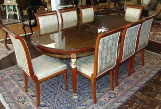 "8 Versace Style Dining Chairs Set of 8 Versace Style Dining Chairs. High Gloss finish. Like New Condition. Each stands 41"" tall x 20"" wide. Condition is very good. Almost new. 2 chairs have slight tears in the fabric. Several Shipping Options Available. Starting Bid $50 for all 8. Auction Estimate $450 - $600."