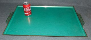 """1950s Mid Century Modern Kyes Moire Glaze Serving Tray 1950s Mid Century Modern Kyes Moire Glaze Serving Tray. Turquoise Green Enamel to both the front and back, Greek key handles. Manufacturer's label of """"Kyes Company of Pasadena, California"""" on the back. Measures 26"""" x 15-3/4"""". Condition is good with minimal wear. No damage. Several Shipping Options Available. Starting Bid $30. Auction Estimate $40 - $50."""