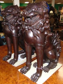 "Pair (2) Large Bronze Sculptures of Foo Dogs Fabulous pair (2) of Bronze Foo Dogs. Large & Heavy. Each measures 29"" tall x 10-1/2"" wide x 22"" deep. Condition is New, Mint. No Damage. Sculptures are made entirely from Bronze. Several Shipping Options Available.  Serious inquires Please contact us. Click on Picture to see additional photos."