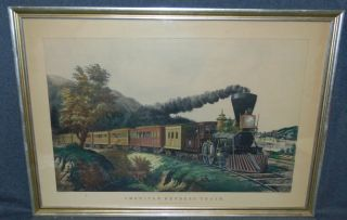 """Framed Currier & Ives Litho Print American Express Train Framed, Vintage Currier & Ives Litho Print, matted and behind glass. Titled """"American Express Train"""". Frame measures 24"""" tall x 34"""" wide. Condition is very good with minimal wear. No damage. Several Shipping Options Available. Starting Bid $50. Auction Estimate $100 - $150."""
