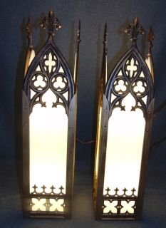 """Pair (2) of Gothic Church Wall Sconces Pair (2) of Gothic Church Wall Sconces. Brass and Glass. Measures 24"""" tall x 6"""" wide x 6"""" deep. Condition is good with minimal wear. No damage. 2 Bulbs. Working Condition. Several Shipping Options Available. Starting Bid $50 for pair. Auction Estimate $150 - $250."""