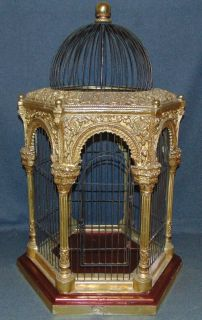 """Vintage Ornate Bird Cage Vintage Ornate Bird Cage. Hexigonal Shape. Measures 34"""" tall x 21"""" wide. Overall condition is good. Wear consistent with age and use. Some Paint losses. Several Shipping Options Available. Starting Bid $50. Auction Estimate $150 - $250."""