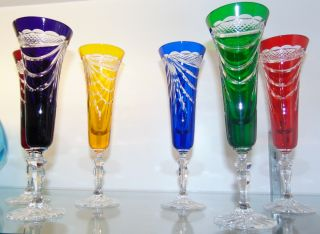 """Set of 6 Multi Color Cut Crystal Champagne Glasses Beautiful Set of 6 Multi Color Cut to Clear Crystal Champagne Glasses. Heavy and high quality European Leaded Crystal. Each measures 9"""" tall. Condition is New, Mint. No Damage. Includes Fitted and lined Gift Box. Several Shipping Options Available. Starting Bid $50 for all 6. Auction Estimate $150 - $250."""
