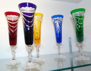 """Set of 6 Multi Color Cut Crystal Champagne Glasses Beautiful Set of 6 Multi Color Cut to Clear Crystal Champagne Glasses. Heavy and high quality European Leaded Crystal. Each measures 9"""" tall. Condition is New, Mint. No Damage. Includes Fitted and lined Gift Box. Several Shipping Options Available. Starting Bid $100 for all 6. Auction Estimate $150 - $250."""