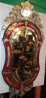 "Traditional Venetian Style Glass Mirror Elegant and Traditional Venetian Style Mirror with Etched Ruby Red Glass Accents. Measures 55"" tall x 26"" wide. Condition is Brand New. No Damage. Several Shipping Options Available. Starting Bid $250. Auction Estimate $300 - $400."