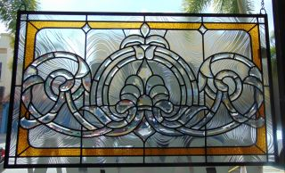"Custom Tiffany Style Stained Glass Hanging Panel Custom Tiffany Style Stained Glass Hanging Panel. High Quality. Measures 20-1/2"" tall x 34-1/2"" wide. Condition is New, Mint. No Damage. Several Shipping Options Available. Starting Bid $80. Auction Estimate $120 - $150."