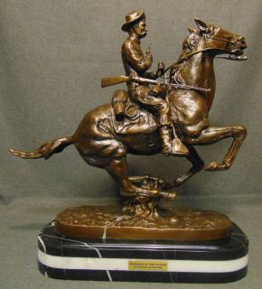 "Bronze Trooper of the Plains after Frederick Remington Western Bronze Sculpture ""Trooper of the Plains"" after Frederick Remington on a Triple Marble Base. Signed. Very Heavy Piece. This Sculpture is made entirely from Bronze with a Marble Base. Measures 21"" tall x 20"" wide x 8-1/2"" deep. Overall condition is Excellent. No Damage. Starting Bid $250. Auction Estimate $250 - $500."