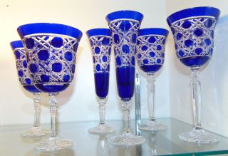 """6 Cobalt Blue Crystal Wine, Water & Champagne Glasses 6 Matching Cobalt Blue Cut to Clear Crystal Glasses. 2 Wine, 2 Champagne and 2 Water. Heavy and high quality European Leaded Crystal. Wine & Champagne glasses measure 9"""" tall each. Water is 7-3/4"""". Condition is New, Mint. No Damage. Includes Fitted and lined Gift Box. Several Shipping Options Available.  Starting Bid $150 for all 6. Auction Estimate $150 - $250."""