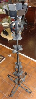 """Vintage Wrought Iron Floor Candleabra Vintage Wrought Iron Candle Floor Candleabra. Measures 53"""" tall x 21"""" wide. Overall condition is good. Wear consistent with age and use. Needs cleaning or re-painting. Several Shipping Options Available. Starting Bid $50. Estimate $80 - $100."""