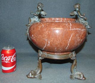 "Rouge Marble & Bronze Figural Urn Rouge Marble & Bronze Figural Urn. Measures 13-1/2"" tall x 12-1/2"" wide. Condition is very good. No damage. Starting Bid $50. Auction Estimate $50 - $400."