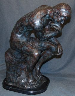 """The Thinker"" Bronze Sculpture by Auguste Rodin ""The Thinker"" Bronze Sculpture on a Black Marble Base after Auguste Rodin (1840-1917). Measures 23"" tall x 13"" wide x 19"" deep. Condition is New, Mint. No Damage. This Sculpture is made entirely from Bronze and Marble. Several Shipping Options Available. Starting Bid $500. Auction Estimate $600 - $750."