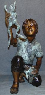 "Bronze Boy and Frogs Fountain Sculpture Bronze Boy and his Frogs Fountain Sculpture. Cast and crafted one piece at a time in the traditional lost wax method. Sculpture functions as a fountain feature as well and is pre-Fitted to accept Water Pump for Fountain Feature. High Quality Bronze with excellent Detail and various shades of patina. Bronze may be used indoor or outdoor. Stands 26-1/2"" tall x 15"" wide. Condition is New, Mint. No Damage. Several Shipping Options Available. Starting Bid $500. Auction Estimate $750 - $1,000."