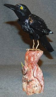 """Hand Carved Black Onyx Crow Sculpture Hand Carved Black Onyx Crow Sculpture on a Multicolor Jasper Base with Green Serpentine Leaf. Measures 9"""" tall. Overall condition is Excellent. Several Shipping Options Available. Starting Bid $70. Auction Estimate $90 - $120."""