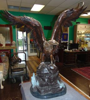 "Life Size Bronze American Bald Eagle Sculpture Life Size Bronze American Bald Eagle Sculpture on a Black Marble Base. Very heavy. Aprox 120-150 lbs. Excellent quality and detail with various shades of patina. Bronze may be used indoor or outdoor. He Stands 44"" tall x 35"" wide. Condition is New, Mint. No Damage. This Sculpture is made entirely from Bronze with a Marble Base. Several Shipping Options Available. Starting Bid $500. Auction Estimate $900 - $1,250."