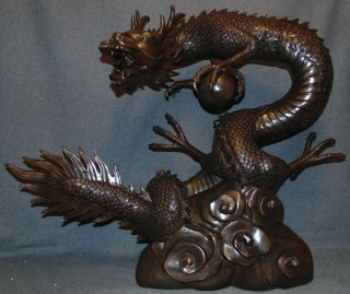 """Bronze Dragon & Sphere Fountain Sculpture Fabulous Asian Style Bronze Dragon & Sphere Fountain Sculpture. Cast and crafted one piece at a time in the traditional lost wax method. Sculpture functions as a fountain feature as well and is pre-Fitted to accept Water Pump for Fountain Feature. High Quality Bronze with excellent Detail and patina. Bronze may be used indoor or outdoor. Stands 27"""" tall x 32"""" long x 16"""" deep. Very Heavy. Condition is New, Mint. No Damage. This Sculpture is made entirely from Bronze. Several Shipping Options Available. Starting Bid $750. Auction Estimate $1,000 - $1,500."""