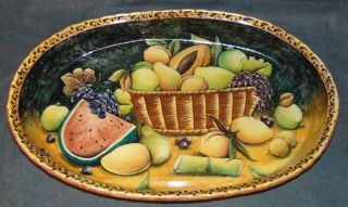 "Hand Painted Ceramic Oval Serving Dish  Large, Hand Painted Ceramic Oval Serving Dish. Fruit Design. Measures 27"" tall x 17"" wide x 4"" deep. Condition is good. No damage. Several Shipping Options Available. Starting Bid $50. Auction Estimate $100 - $150."