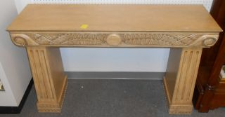 "Art Deco Style 2 Sided Console Table Art Deco Style Console Table. Carved on both sides. Stands 35"" tall x 57"" wide x 17"" deep. Condition is very good with minor surface scratches from age. No damage. Starting bid $120. Auction Estimate $200 - $250."