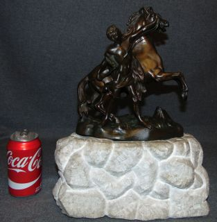 """VINTAGE BRONZE MARLY HORSE SCULPTURE on MARBLE Vintage Bronze Marly Horse Sculpture on a Heavy Marble Base. Unsigned. Measures 16"""" tall x 12"""" wide x 5"""" deep. Overall condition is good. Wear consistent with age. Starting Bid $30. Auction Estimate $50 - $120."""