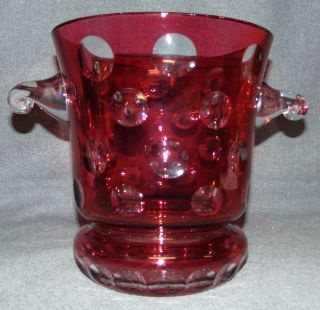 "Ruby Red European Cut Crystal Champagne Bucket Ruby Red European Cut Crystal Champagne or Ice Bucket. Heavy and Thick Lead Crystal. Measures 10"" tall x 12"" wide at the handles. Condition is New, Mint. No Damage. Several Shipping Options Available. Starting Bid $100. Auction Estimate $200 - $250."
