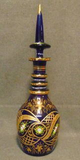 """Vintage Hand Painted Murano Cobalt Glass Decanter Venetian Murano Cobalt Blue Glass Decanter and Stopper. Hand Blown and Painted. Measures 19-1/4"""" tall. Condition is very good to excellent. No Damage at all. Starting Bid $70. Auction Estimate $80 - $120."""