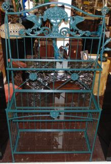 """Wrought Iron & Glass Bakers Rack Wrought Iron & Glass Bakers Rack. Measures 72"""" tall x 41"""" wide x 17-1/2"""" deep. 4 Glass shelves. Condition is Like New. Very good. No Damage. Several Shipping Options Available. Starting Bid $50. Auction Estimate $80 - $120."""