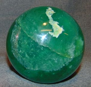 "Natural Green Fluorite Quartz Crystal Ball Natural Green Fluorite Quartz Crystal Ball or Sphere. Aprox 115mm. 4-1/2"" diameter. Condition is Excellent. Mint. Several Shipping Options Available. Starting Bid $80. Auction Estimate $100 - $150."