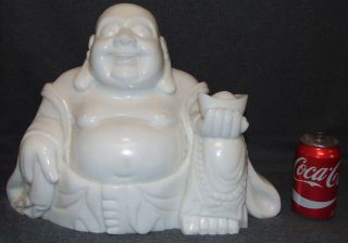"""Large Carved Stone Happy Buddha 50 lbs. Large, Hand Carved White Stone Sitting Happy Buddha. He measures 13"""" tall x 18"""" wide. Weight is aprox 50 lbs. Condition is New, Mint. No Damage. Several Shipping Options Available. Starting Bid $200. Auction Estimate $350 - $500."""
