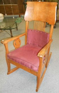 """Antique Oak Rocking Chair Antique Oak Rocking Chair. Circa 1900. Measures 42"""" tall x 24"""" wide. Condition is good with some minor wear and scratches typical from age. Several Shipping Options Available. Starting Bid $30. Auction Estimate $40 - $50."""