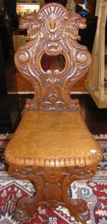 """Antique Italian Carved Oak Sgabello Chair  Antique Italian Carved Oak Sgabello Chair. A Sgabello is a type of chair or stool typical of the Italian Renaissance. Measures 42-1/2"""" tall x 18"""" wide x 22"""" deep. Condition is very good with minimal wear. 1 small chip on back side (see close-up photo). Several Shipping Options Available. Starting Bid $200. Auction Estimate $250 - $300."""