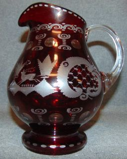 "Vintage Ruby Cut to Clear Crystal Pitcher Vintage Ruby Red, Cut to Clear Crystal Pitcher. Bohemian style. Measures 8-1/2"" tall. Condition is Like New. Very good. No Damage. Several Shipping Options Available. Starting Bid $30. Auction Estimate $50 - $70."
