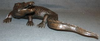 """Bronze Crocodile Sculpture Realistic  Realistic Bronze Crocodile Sculpture. Excellent Detail. Measures 22"""" long x 12"""" wide. Condition is New, Mint. No Damage. This Sculpture is made entirely from Bronze. Several Shipping Options Available. Starting Bid $150. Auction Estimate $250 - $350."""