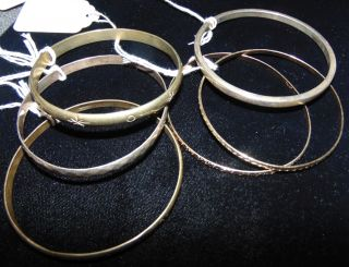 6 Misc Sterling Silver Bangle Bracelets 6 Misc Sterling Silver Bangle Bracelets. Condition is good. No Damage. Several Shipping Options Available. Starting Bid $30. Auction Estimate $50 - $70.