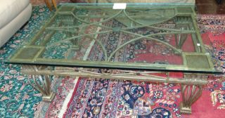 """Large Wrought Iron and Glass Coffee Table Large Wrought Iron and Glass Coffee Table. Very Heavy. Measures 21"""" tall x 54"""" wide x 38"""" deep. Condition is excellent to very good with minimal wear. No damage. Several Shipping Options Available. Starting Bid $50. Auction Estimate $70 - $90."""