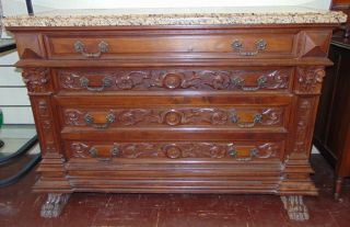 """Antique Carved Walnut & Granite Chest of Drawers Antique Italian Carved Walnut Chest of Drawers with a Beveled Granite Top. Circa 1880. Measures 37"""" tall x 55"""" wide x 22"""" deep. Condition is good with minimal wear. No damage. Several Shipping Options Available. Starting Bid $200. Auction Estimate $350 - $500."""