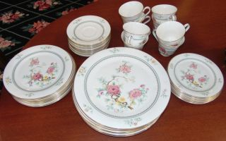 """40 piece Royal Doulton """"Kismet"""" Dish Set 40 piece English Royal Doulton """"Kismet"""" Dish Set #5054. Includes 8 Pieces Each of Large Plates (10-1/2""""), Medium Plates (8""""), Small Plates (6-1/2""""), Cups and Saucers. Bottom is stamped with makers mark. Condition is very good. No damage. Starting Bid $20. Auction Estimate $20 - $60."""