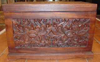 """Hand Carved Trunk Box Hand Carved Trunk Box. Measures 15"""" tall x 23"""" wide x 13"""" deep. Condition is very good with minimal wear. No damage. Several Shipping Options Available. Starting Bid $80. Auction Estimate $100 - $150."""
