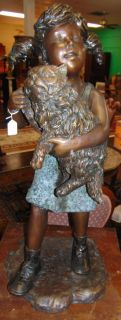 """Bronze Sculpture of a Young Girl with Her Cat Lovely Bronze Sculpture of a Young Girl with Her Cat. Cast and crafted one piece at a time in the traditional lost wax method. Great detail with various shades of patina. Bronze may be used indoor or outdoor. She measures 36"""" tall. Very heavy. Condition is New, Mint. No Damage. This Sculpture is made entirely from Bronze. Starting Bid $350. Auction Estimate $500 - $600."""