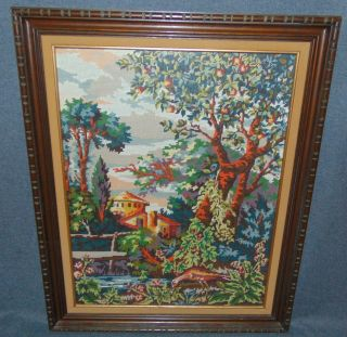"""Framed Needlepoint Art 1960s Vintage Framed Needlepoint Textile Art. Lovely Landscape scene. Frame Measures 32"""" tall x 26"""" wide. Condition is very good with minimal wear. No damage. Several Shipping Options Available. Starting Bid $40. Auction Estimate $50 - $80."""
