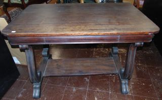 """Antique Mahogany Empire Revival Desk Antique Mahogany Empire Revival Desk by Knoxville Tables. Circa 1920's - 1930. Single Drawer. Measures 29"""" tall x 42"""" wide x 25-1/2"""" deep. Condition is fair to good with minimal wear. Several Shipping Options Available. Starting Bid $20. Auction Estimate $50 - $60."""