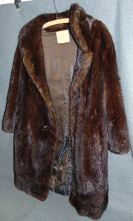 Vintage Whiskey Mink Coat David Sopin Philly Vintage Whiskey Mink Coat by David Sopin of Philadelphia. Overall condition is good. 3 Missing buttons are in pocket (see photos). Wear consistent with age and use. Several Shipping Options Available. Starting Bid $150. Auction Estimate $250 - $300.
