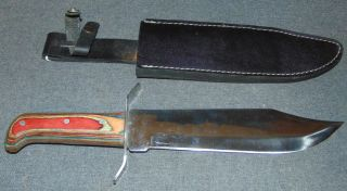 "Large M & F Imports Rostfre Inox Hunting Knife with Sheath Large M & F Imports Rostfre Inox Hunting Knife with Leather Sheath. Blade measures 10"" long. Total of 15"" long. Condition is good with minimal wear. No damage. Several Shipping Options Available. Starting Bid $20. Auction Estimate $40 - $50."