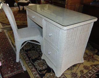 """Wicker 3 Drawer Writing Desk and Chair Glass top Wicker 3 Drawer Writing Desk and Chair. Desk measures 32"""" tall x 44"""" wide x 22-1/2"""" deep. Condition is good. No damage. Several Shipping Options Available. Starting Bid $70. Auction Estimate $80 - $90."""