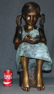 "Bronze Girl Eating an Apple Sculpture Lovely Bronze Sculpture of a Young Girl, Eating an Apple, sitting on a Log. High Quality Bronze with excellent Detail and patina. Cast and crafted one piece at a time in the traditional lost wax method. Bronze may be used indoor or outdoor. Measures 26"" tall x 11"" wide x 13"" deep. Condition is Brand New, Mint. No Damage at all. Several Shipping Options Available. Starting Bid $500. Auction Estimate $750 - $900."