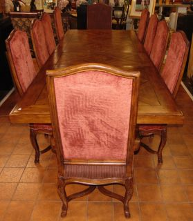 """11 Ft. Dining Table and 10 Chairs  Large and Magnificent Dining Table and 10 Chairs. 2 Captains chairs and 8 side chairs. 2 Arm Chairs are 48"""" tall x 25"""" wide. Side 8 Chairs measure 48"""" tall x 22"""" wide. Table measures 30"""" tall x 88"""" wide x 44"""" deep without leaves. 2 leaves included are each an additional 22"""". 132"""" or 11 feet total. Condition is very good to Excellent. No damage. Several Shipping Options Available. Starting Bid $1,500. Auction Estimate $2,000 - $3,000."""